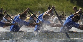 men rowing together